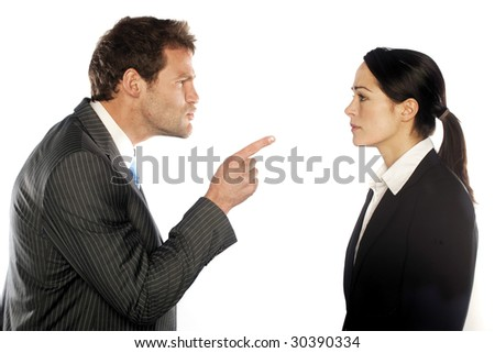 business couple looking at each other angrily - stock photo