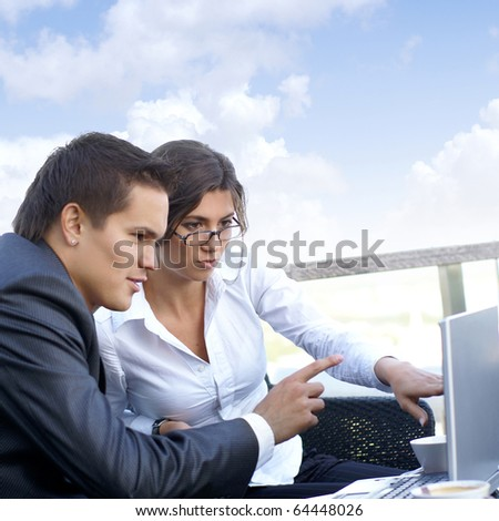 Business couple (Warning! Only woman\'s face is in focus, man\' face is out of focus!)