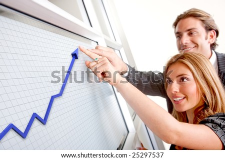 Business couple with a graph - Business success