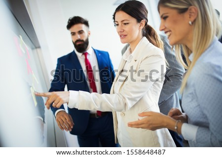 Business coworkers discussing new ideas and brainstorming in a modern office #1558648487