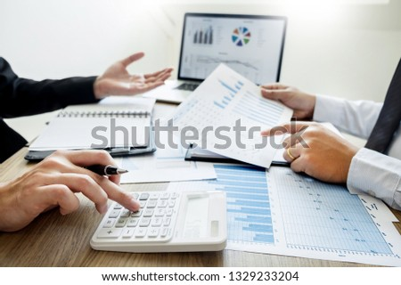 Business creative coworkers team Meeting Discussing showing the results chart and graph Work #1329233204