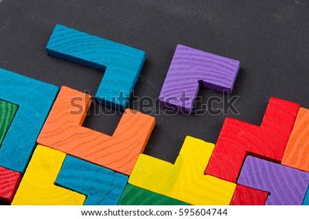 Business creative solution concept - jigsaw on the blackboard