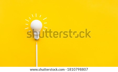Business creativity and inspiration concepts with lightbulb and pencil on yellow background. motivation for success.think big ideas