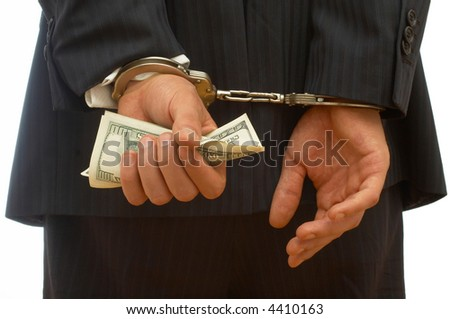 business crime concept with handcuffs and dollar