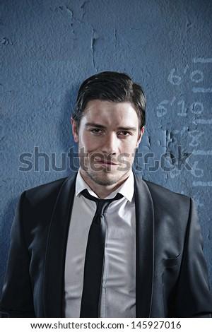 Business criminal poses for his mug shot