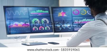 Business Data Analyst Using Computer. African American Advisor ストックフォト ©