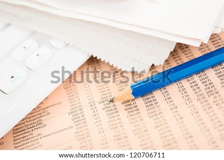 Business data in Newspaper with pencil and keyboard