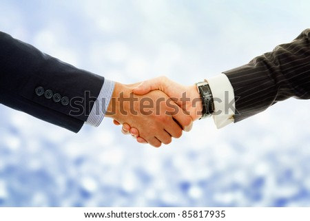 Business deal - Closeup of a handshake against blur background
