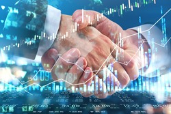 Business deal concept with businessmen handshaking and digital display with forex chart graphs, quotes and growing diagram. Double exposure