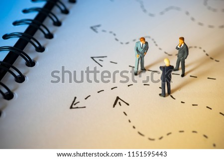 Business decision concept. Businessman thinking with many arrow path.