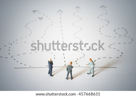 Business decision concept. Businessmen standing and giving advice with arrow pathway choice.  ストックフォト ©