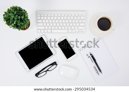 Business desk with a keyboard, mouse and pen on white table #295034534