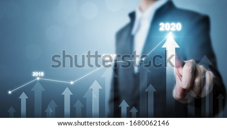 Business development to success and growing growth year 2020 concept, Businessman pointing line dot graph and arrow corporate future growth plan