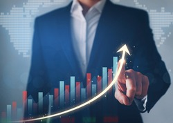 Business development to success, profit and growing  plan. Businessman finger pointing increase arrow graph chart.
