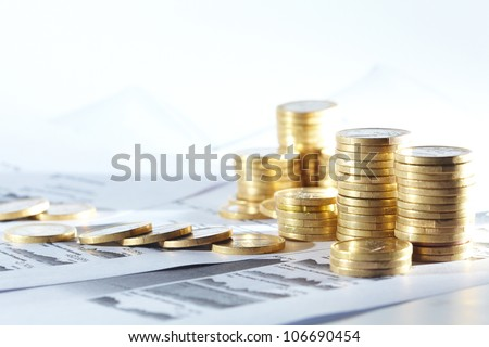 Business diagram on financial report with coins