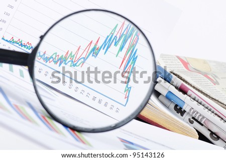 Business diagramme with magnifying glass, workplace businessman