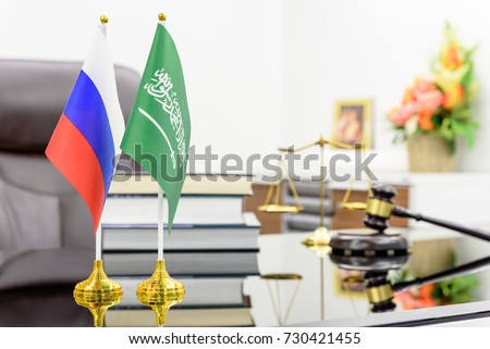 Business dialogue, military and oil agreement concept : National flags of Russia and Saudi Arabia on a table. A symbol of cooperation between two nations, Moscow / Kremlin and Riyadh, an Islamic state #730421455