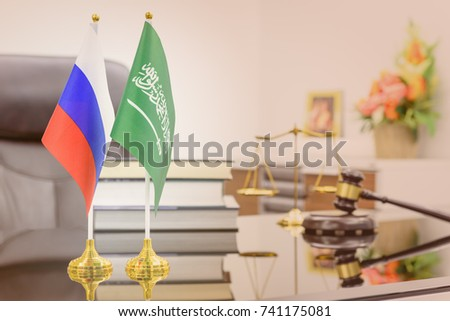 Business dialogue, military and oil agreement concept : National flags of Russia and Saudi Arabia on a table. A symbol of cooperation between two nations, Moscow / Kremlin and Riyadh, an Islamic state #741175081