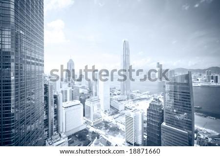 Business district skyline - blue tone (Vertical version: #18871684 / Regular colors: #17626312) - stock photo