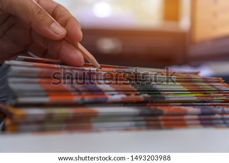 Business Documents concept : Businessman hands working in Stacks Brochures paper files for checking document achieves reports on busy work desk office #1493203988
