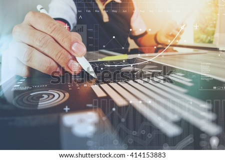 business documents on office table with smart phone and digital tablet and graph financial with social network diagram and man working in the background #414153883