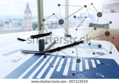 business documents on office table with smart phone and digital tablet as workspace business with blank screen computer laptop with social media diagram