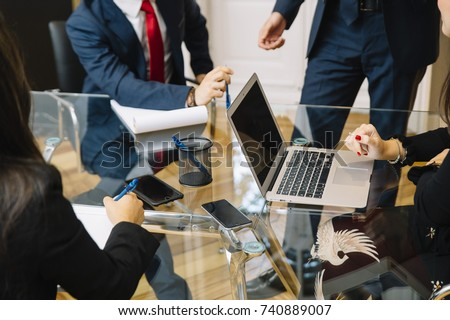 business documents on office table with smart phone and laptop computer  #740889007