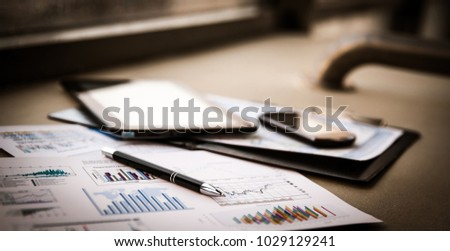 business documents with charts growth, keyboard and pen.