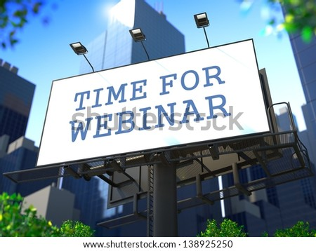 """Business Education Concept. Slogan""""Time for Webinar"""" on Billboard on the Background of a Modern Business Center."""