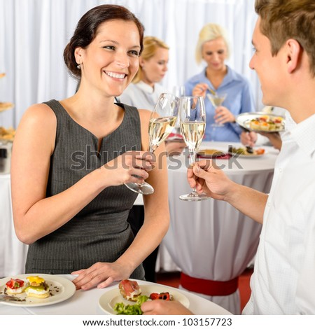 Business event two colleagues celebrate toast drink enjoy catering buffet