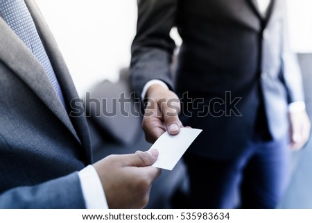 Free business executive exchanging business card photos page 243 business executive exchanging business card 535983634 colourmoves