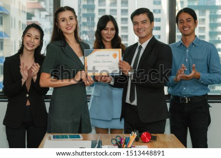 business executive management giving certificate of excellence to executive team members awarding for success recieving from good job performance with other team members participate in celebrating