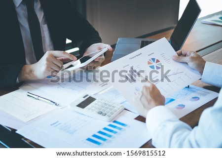 Business executive partner cooperation conference in investment ideas marketing planning and presentation finance project at meeting and strategy of business making to successful and growth profit.