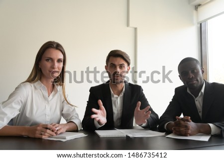 Business executive team three diverse people webinar speakers talking looking at camera record video training make online corporate conference call in office, videoconference concept, webcam view