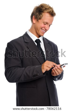 Business executive texting on his cell phone