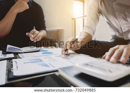 Business executives analyzing on valuation data paper