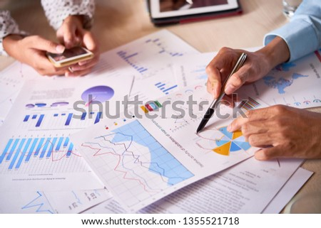 Business executives discussing company activity #1355521718