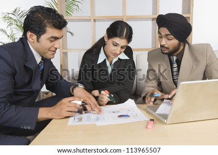 Business executives discussing in a meeting