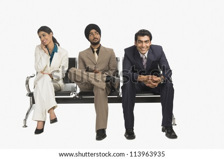 Business executives sitting on a bench