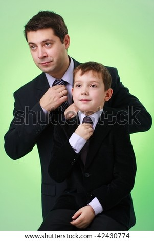 Business family. Father and son on a green background.