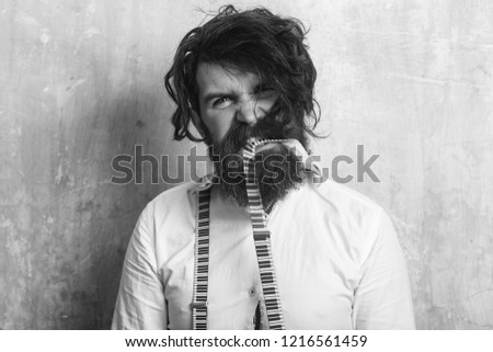 Business fashion and beauty. Fashion model with stylish hair. Hipster in shirt and suspenders. Man with long beard and mustache on angry face. Guy or businessman at textured wall. #1216561459