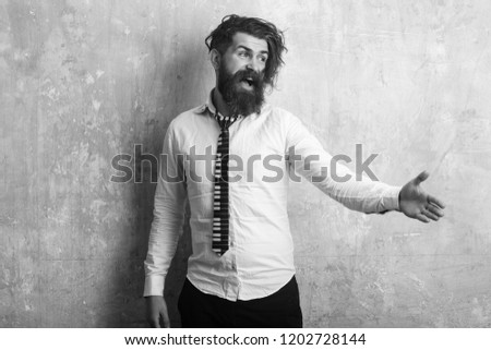 Business fashion and beauty. Guy hold hand for handshake. Man with long beard and mustache on happy face. Fashion model with stylish hair on textured wall background Hipster in shirt and musical tie. #1202728144