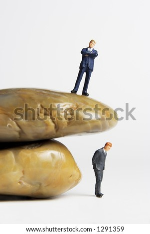 Business figures and rocks
