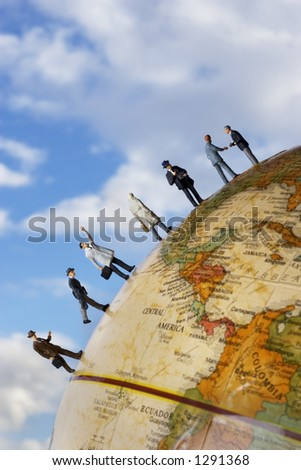 Business figures on a globe