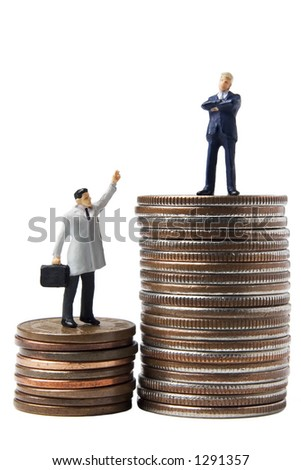 Business figures on a stack of coins
