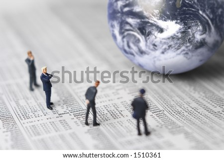 Business figures, stock report and globe