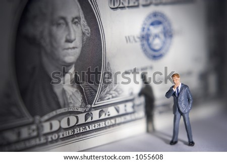 Business figures with a dollar