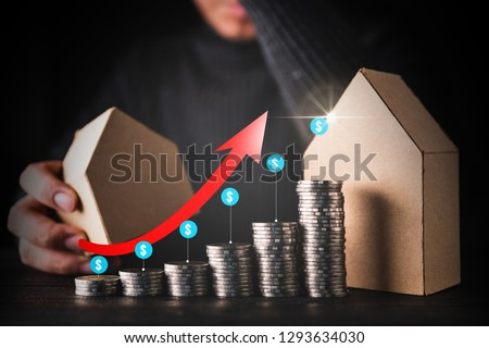 business finanacial mortage with businessman thinking with money coin stack and house paper model black background