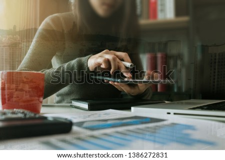 Business finance and business people use smartphones with laptops at the office. #1386272831
