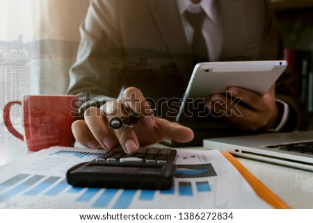 Business finance and business people use smartphones with laptops at the office. #1386272834